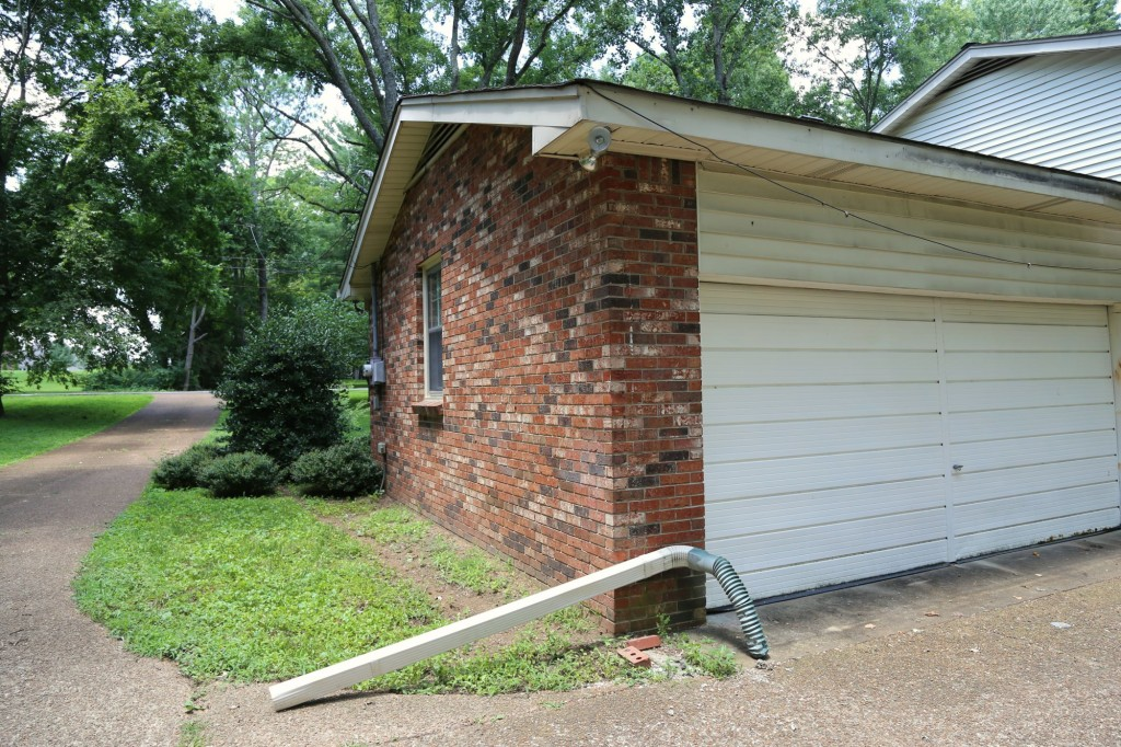 The gutters are the most clear and present danger.  While the rugs are worn and the walls need some TLC, the gutters are in a progressive state of collapse.  On this  side, they have completely fallen away.