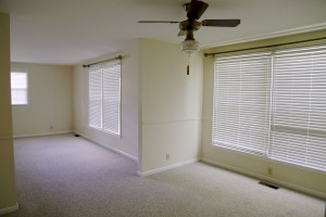 View of the dining room windows and entrance into the living room.
